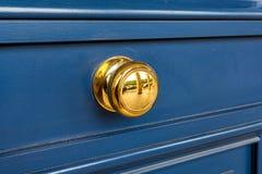 Yellow handle on wooden door. Royalty Free Stock Photography