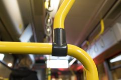 Yellow handles. Inside a bus stock photos