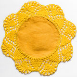 Yellow handmade lace tablecloth texture on white background Photographie stock libre de droits