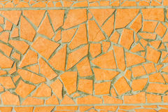 Yellow handmade mosaic work from broken tiles in Madeira. Royalty Free Stock Photography