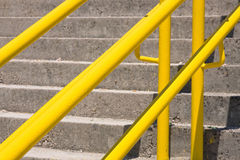 Yellow handrail. A metal yellow handrail along the stairways stock photography