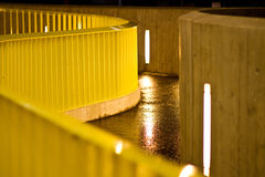 Yellow handrail. Metallic handrail with yellow paint and a curved path for pedestrians stock photos