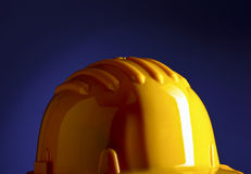 Yellow handyman's  helmet Royalty Free Stock Images