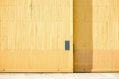 Yellow hangar door Stock Photography