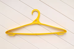 Yellow hangers for clothes Royalty Free Stock Image
