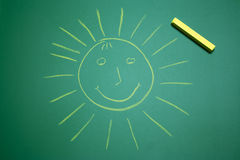 Yellow happy sun on school panel Stock Photos