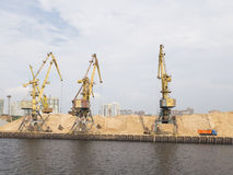 Yellow harbor cranes in North Port in Moscow Stock Photos