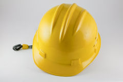 Yellow hard hat. On white Stock Images