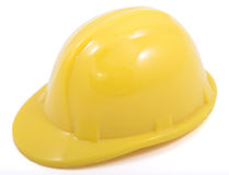 Yellow hard hat. This is a minature yellow hard hat shot on white background Stock Image