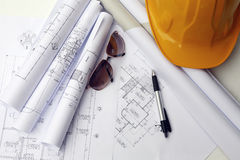 Yellow hard hat and blueprints Royalty Free Stock Image