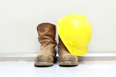 Yellow hard hat and boots Royalty Free Stock Photography
