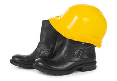 Yellow hard hat and boots over white Royalty Free Stock Photos