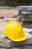 Yellow hard hat on brick blocks Stock Images