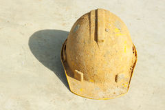 Yellow hard hat dirty Royalty Free Stock Image