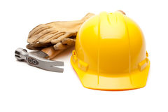Yellow Hard Hat, Gloves and Hammer on White Stock Photos