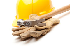Yellow Hard Hat, Gloves and Hammer on White Royalty Free Stock Image