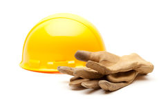 Yellow Hard Hat and Gloves on White Royalty Free Stock Image