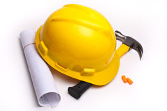 A yellow hard hat and hammer. On white Stock Photography