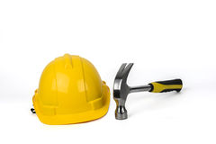 Yellow Hard Hat and Hammer  Stock Images