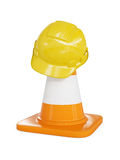 Yellow hard hat on highway traffic cone. Under construction concept background - yellow hard hat on orange highway traffic construction cone with white stripes royalty free stock photography