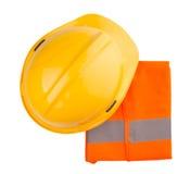 Yellow Hard Hat and Orange Vest I. Yellow hard hat and orange reflective vest over white background Royalty Free Stock Photos