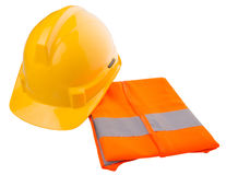 Yellow Hard Hat and Orange Vest II. Yellow hard hat and orange reflective vest over white background Royalty Free Stock Photography