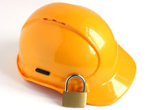 Yellow hard hat with padlock Royalty Free Stock Image
