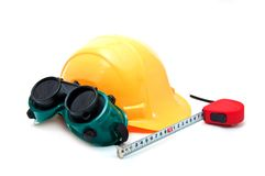 Yellow hard hat and protective goggles Royalty Free Stock Photography