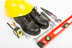 Yellow hard hat and tools Royalty Free Stock Image
