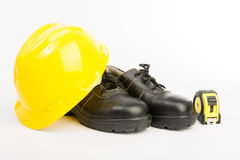 Yellow hard hat and tools Stock Photography