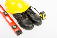 Yellow hard hat and tools Royalty Free Stock Photo
