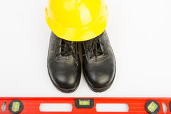 Yellow hard hat and tools Stock Images