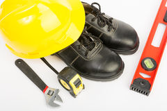 Yellow hard hat and tools Stock Photo