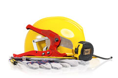 Yellow hard hat with tools Royalty Free Stock Image