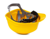Yellow hard hat upside down. Small natural shadowo under object Stock Photos