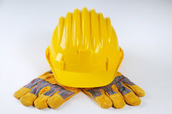 Yellow Hard Hat And Work Gloves Royalty Free Stock Photos
