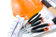 Yellow hard hat and working tools Stock Images