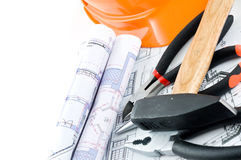 Yellow hard hat and working tools Royalty Free Stock Photo