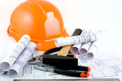 Yellow hard hat and working tools Stock Photo