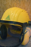 Yellow hardhat. Employment protection against noise induced hearing loss Stock Photography