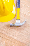 Yellow hardhat and claw hammer on vintage wooden Royalty Free Stock Photography