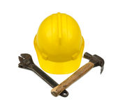 Yellow hardhat with crossed hammer and wrench Stock Photo