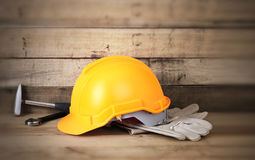 Yellow hardhat and leather gloves Stock Photo