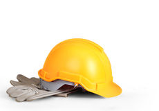 Yellow hardhat and old leather gloves Royalty Free Stock Photo