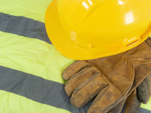Yellow hardhat, old leather gloves Stock Photo