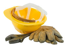 Yellow hardhat, old leather gloves royalty free stock photos