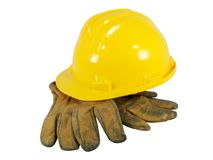 Yellow hardhat and old leather gloves Stock Image