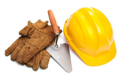 Yellow hardhat and old leather gloves isolated Royalty Free Stock Photography