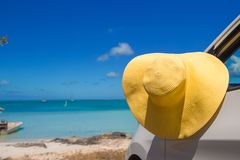 Yellow hat on the car at caribbean island Royalty Free Stock Photography