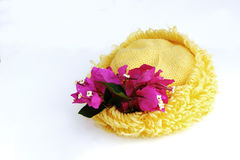 Yellow hat and paper flower on white bg Stock Photography